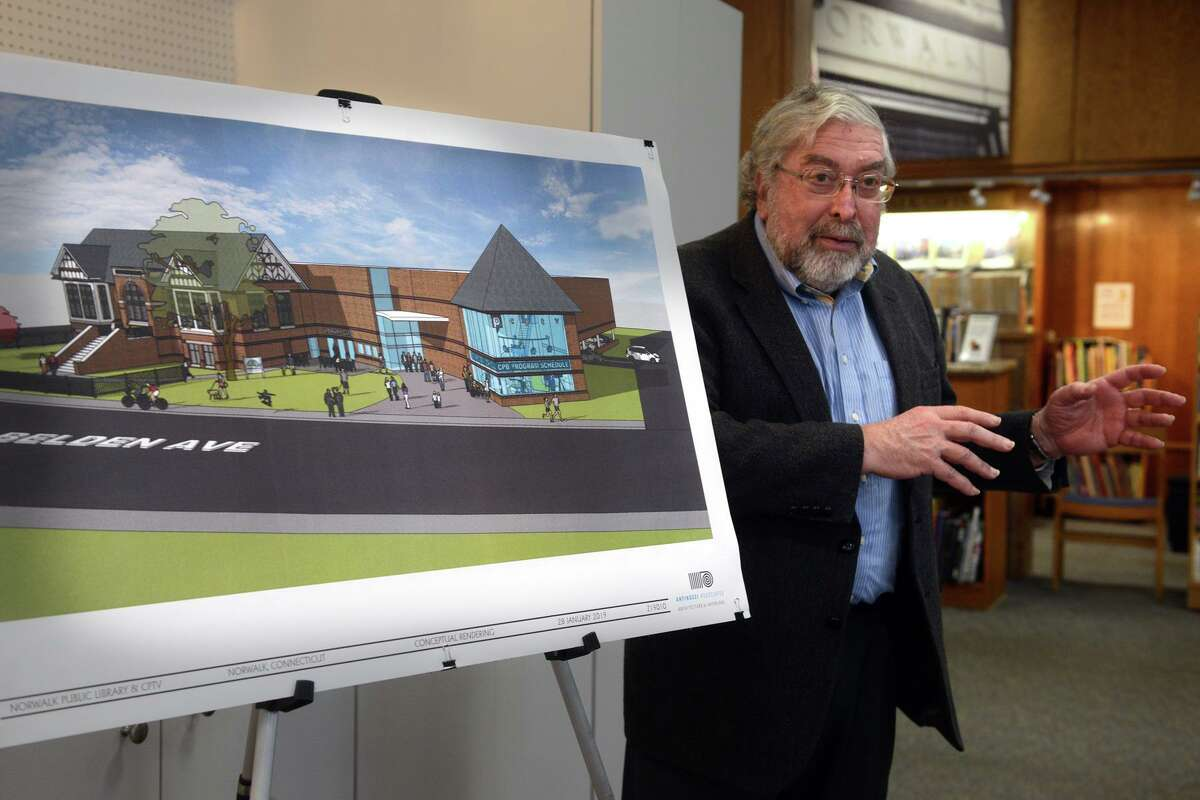 Alex Knopp, president of the Norwalk Public Library Board of Directors, speaks during a news conference at library in 2019.
