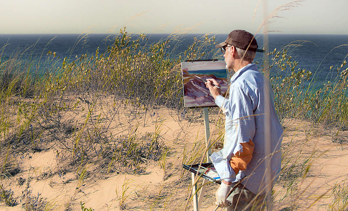 Artist David Westerfield is working on a painting depicting 'the cut', part of Onekama's history. (Courtesy photo)