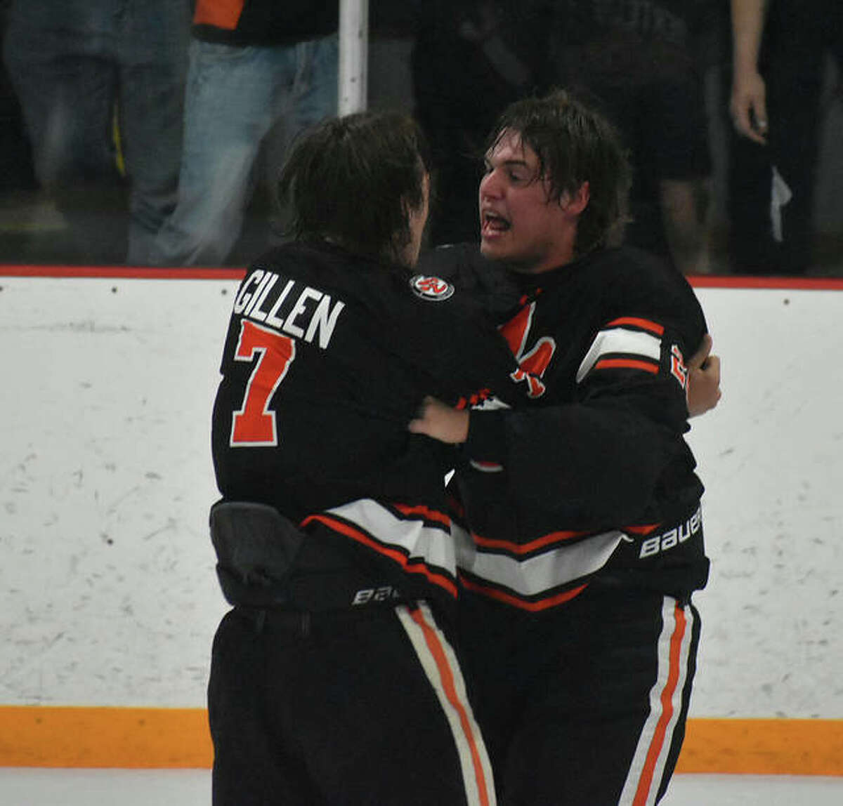 The Edwardsville Tigers celebrate capturing the MVCHA championship for the 12th time in program history.