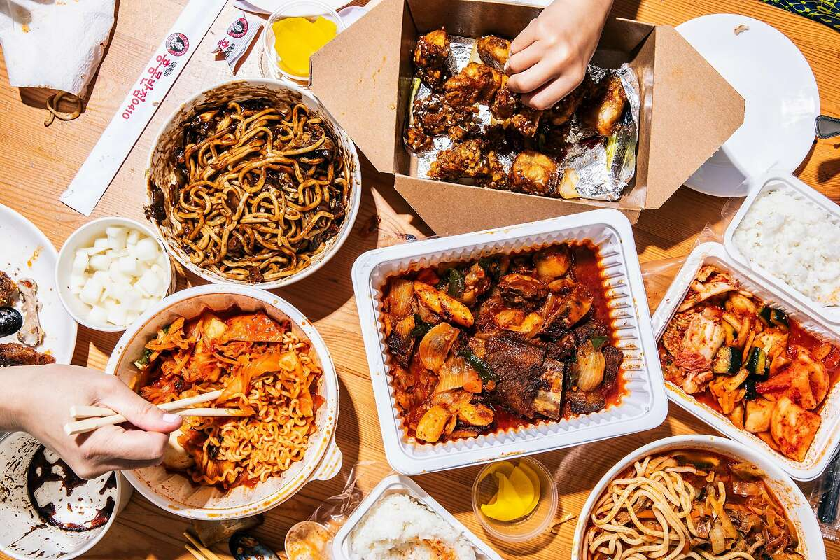 This spread from H Mart's food court in S.F. includes jajangmyeon from Paik's Noodle (clockwise from top left); chili soy garlic wings from Left Wing; Kalbijjim (center) with kimchi from Daeho; jjampong from Paik's Noodle; and rapoki from Da S.F.C.