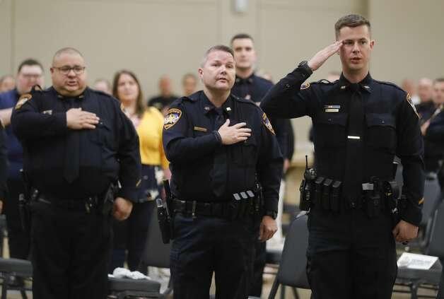 Specialist Kevin Hataway saultes during the Montgomery County Sheriff's Office promotion and awards ceremony, Thursday, May 27, 2021, in Conroe. Photo: Jason Fochtman/Staff Photographer / 2021 © Houston Chronicle