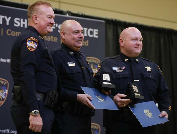 Specialists Steven Squier and Lee Knudsen receive a compassionate award during the Montgomery County Sheriff's Office promotion and awards ceremony, Thursday, May 27, 2021, in Conroe. Photo: Jason Fochtman/Staff Photographer / 2021 © Houston Chronicle