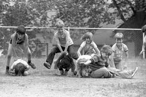 Lincoln school held a track day, an event that drew a lot of enthusiasm from Lincoln's students as this photograph of second graders engaged in a rough and tumble game of leapfrog makes clear. The photo was published in the June 1, 1981 issue of the News Advocate. (Manistee County Historical Museum photo)