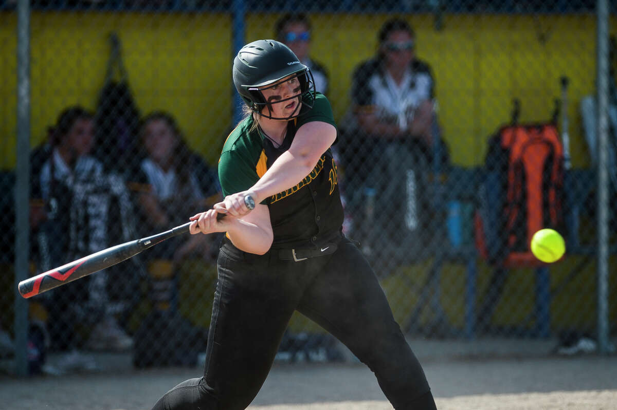 Dow High's Izzy Diehl takes a swing during a May 18, 2021 game against Midland High.
