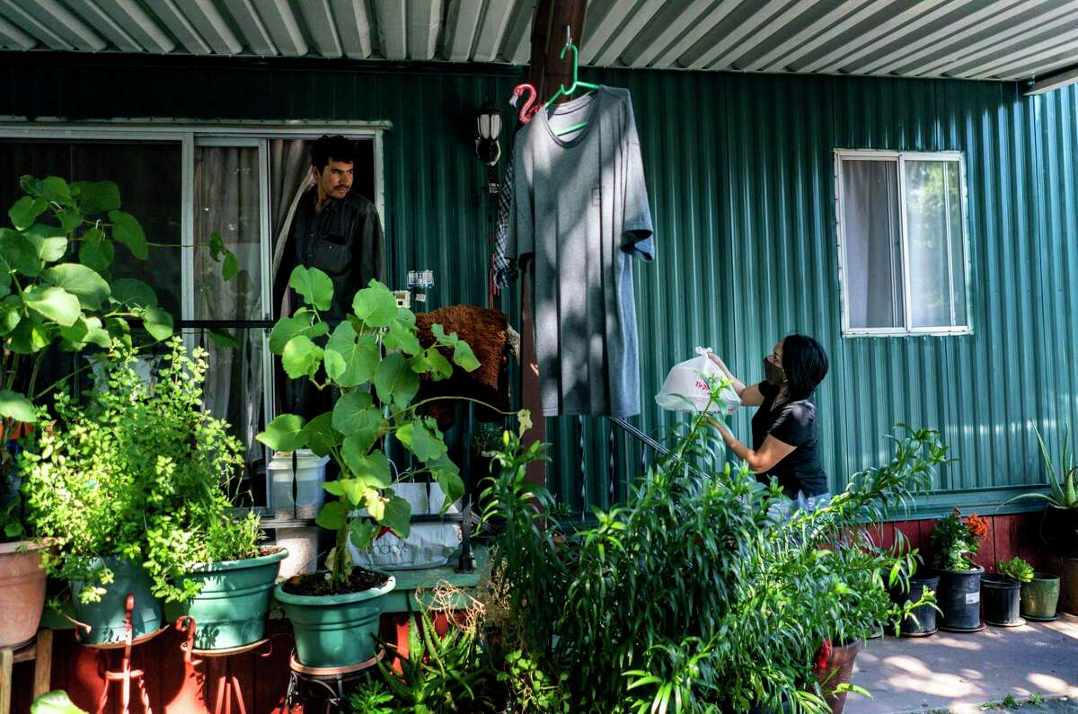 Mayra Arreguin has become a familiar face to the families living in this Cloverdale neighborhood. Throughout the pandemic, she has delivered food to help the individuals, some of whom expressed unease about coronavirus vaccines.