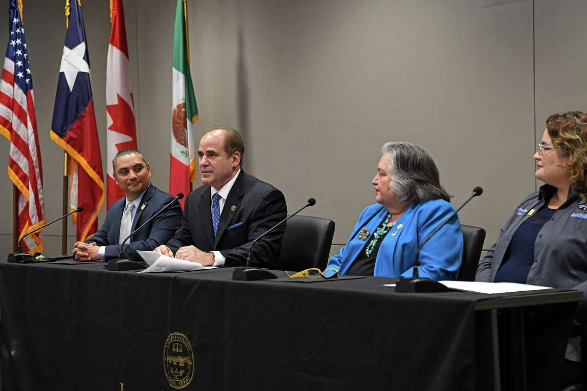 Laredo College president Dr. Ricardo Solis, second to left, gives his remarks after the college officially announces he will move to the South Texas College as its next president on Thursday, May 27, 2021. He sits next to board VP Jorge