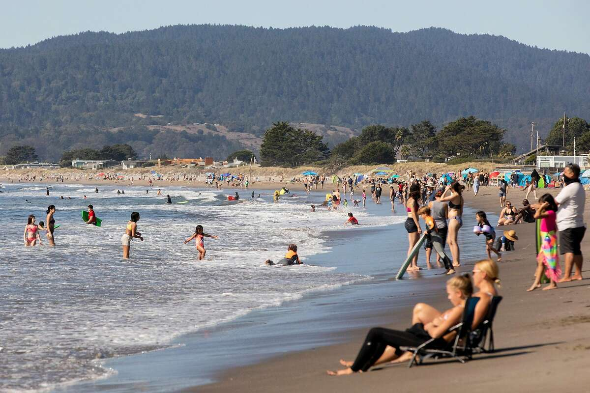 Crowds gather to enjoy the warm weather and ocean waves at Stinson Beach in Stinson Beach, Calif. Friday, October 16, 2020. Near normal temperatures will continue through Saturday, with a