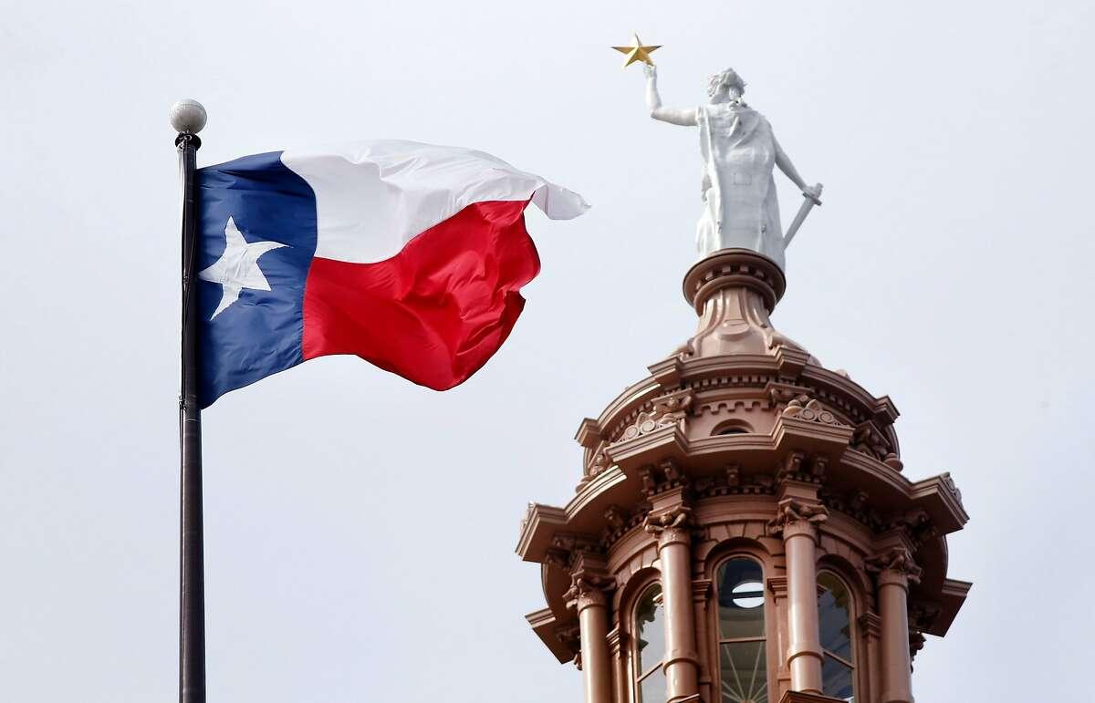 The Texas flag flies over the Texas Capitol in Austin, Texas. (Tom Fox/The Dallas Morning News/TNS)