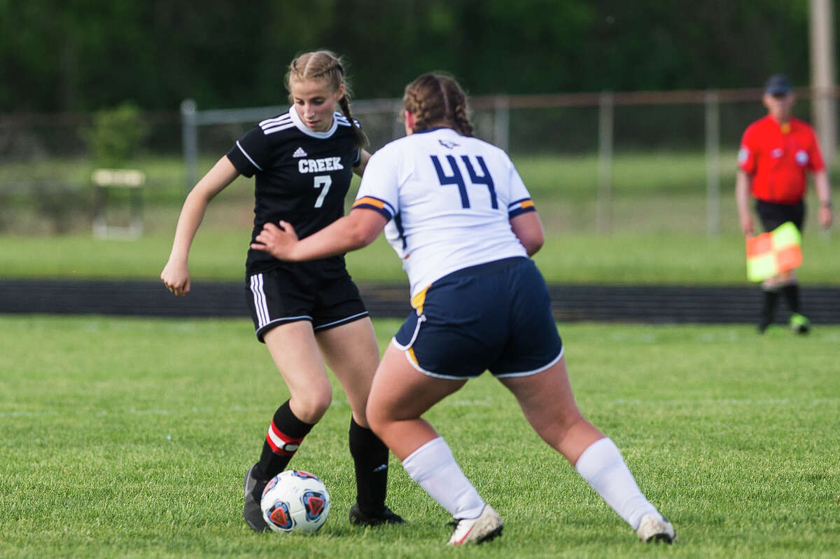 Bullock Creek's Jacey Herst dribbles the ball during the Lancers' district opener against Shephed on Wednesday, May 26, 2021 at Bullock Creek High School.