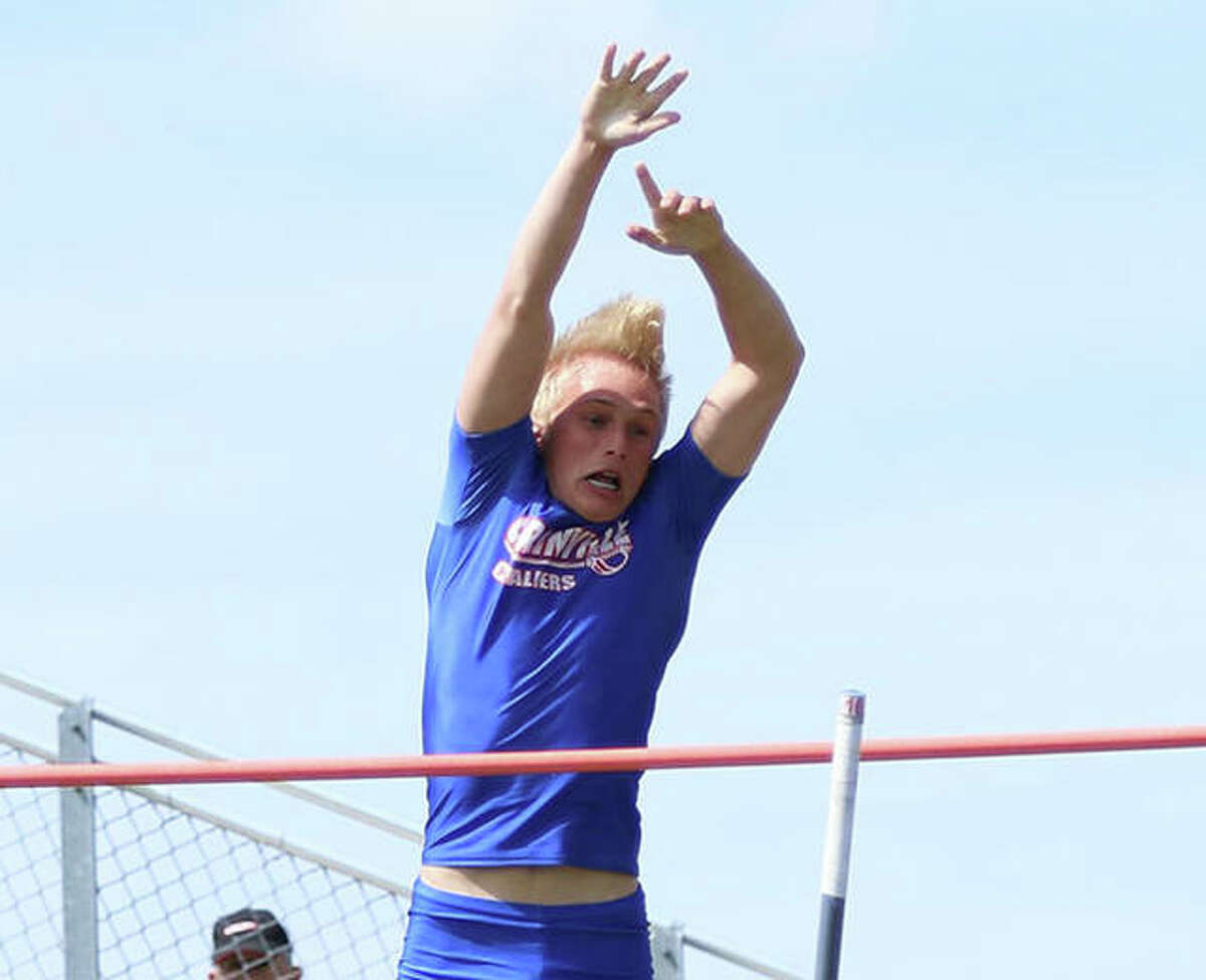 Carlinville's Dustin Roberts releases the pole and clears the bar in the pole vault in the 2019 South Central Conference track meet at Hillsboro. Roberts finished third as a sophomore and came back Thursday as a senior to win the pole vault at the SCC Meet in Pana.