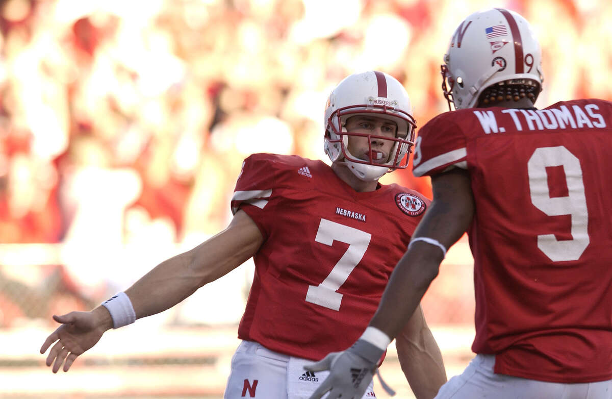 10 Nov 2001: Quarterback Eric Crouch #7 of Nebraska is congratulated by teammate Wilson Thomas #9 after Crouch ran the ball in for a touchdown against Kansas State during the first half at Memorial Stadium in Lincoln, Nebraska. DIGITAL IMAGE. Mandatory Credit: Elsa/ALLSPORT