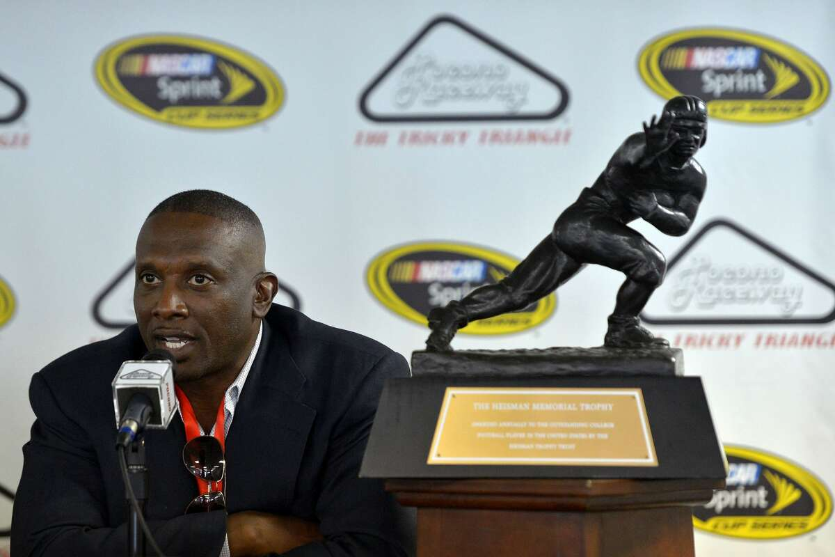 LONG POND, PA - AUGUST 03: Heisman Trophy winner Tim Brown speaks to the media during a press conference before practice for the NASCAR Sprint Cup Series Pennsylvania 400 at Pocono Raceway on August 3, 2012 in Long Pond, Pennsylvania. (Photo by Drew Hallowell/Getty Images for NASCAR)