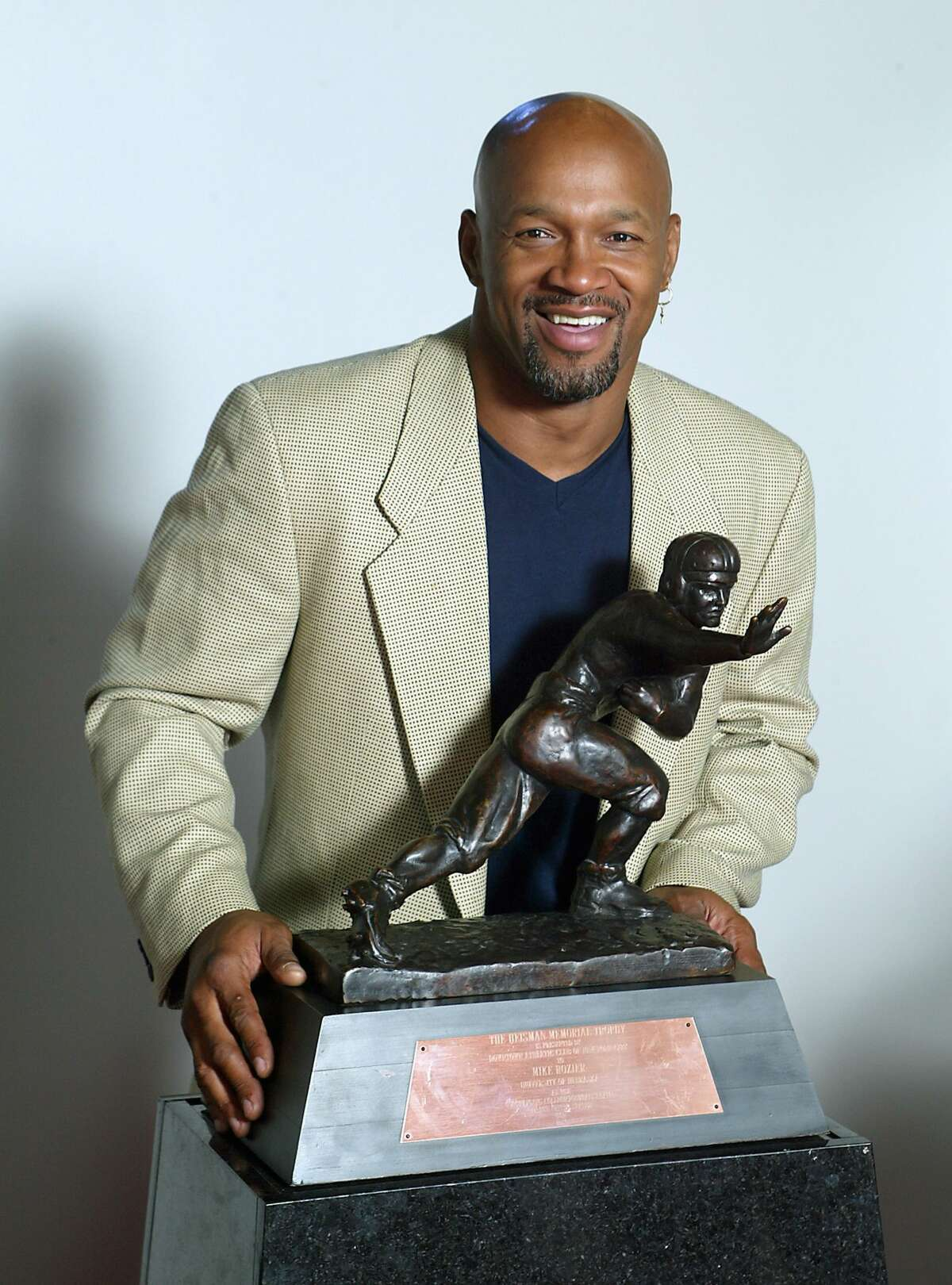 LINCOLN, NE- 1983: Mike Rozier #30 of the University of Nebraska Cornhuskers poses with his Heisman Trophy in Lincoln, Nebraska. (Photo by Nebraska/Collegiate Images/ Getty Images)