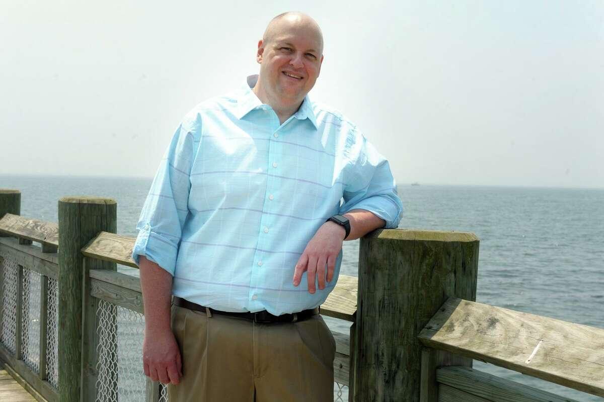 Stan Osoweicki on the pier at Walnut Beach, near his home in Milford, Conn. May 26, 2021.
