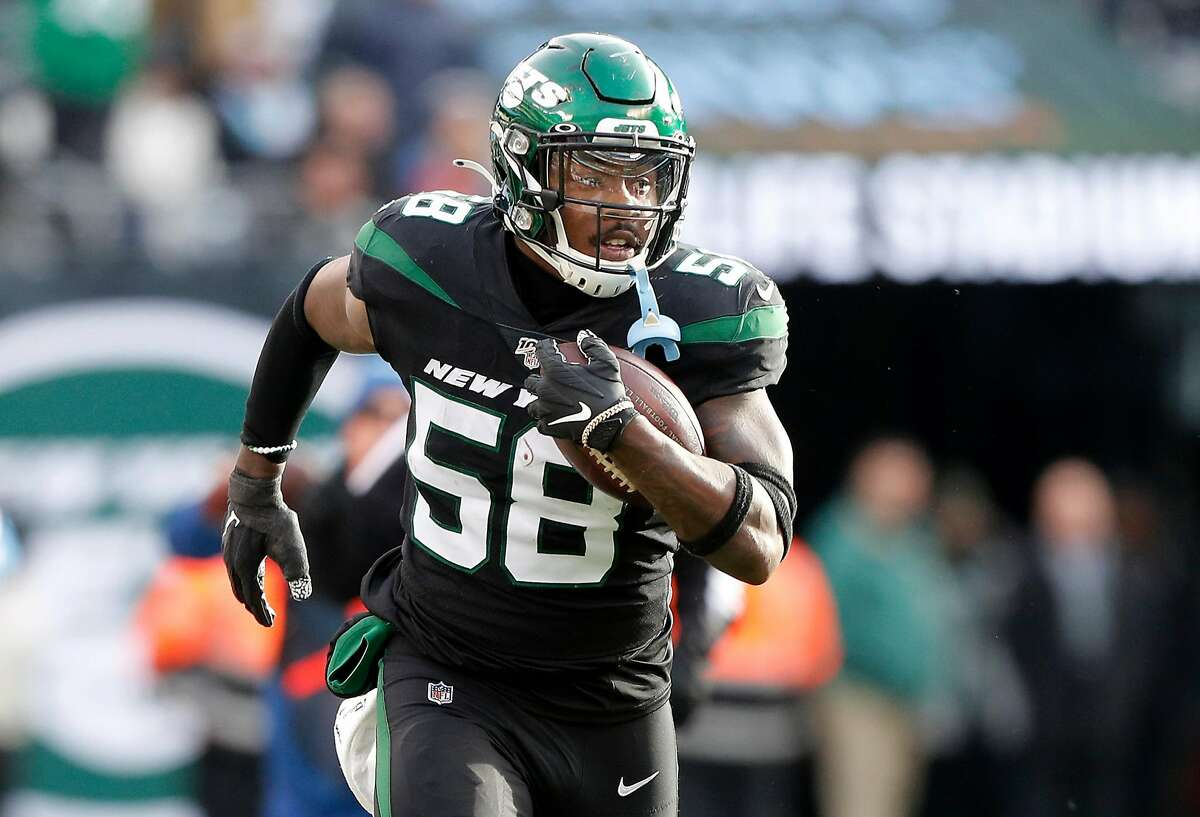 EAST RUTHERFORD, NEW JERSEY - DECEMBER 08: (NEW YORK DAILIES OUT) James Burgess #58 of the New York Jets in action against the Miami Dolphins at MetLife Stadium on December 08, 2019 in East Rutherford, New Jersey. The Jets defeated the Dolphins 22-21. (Photo by Jim McIsaac/Getty Images)