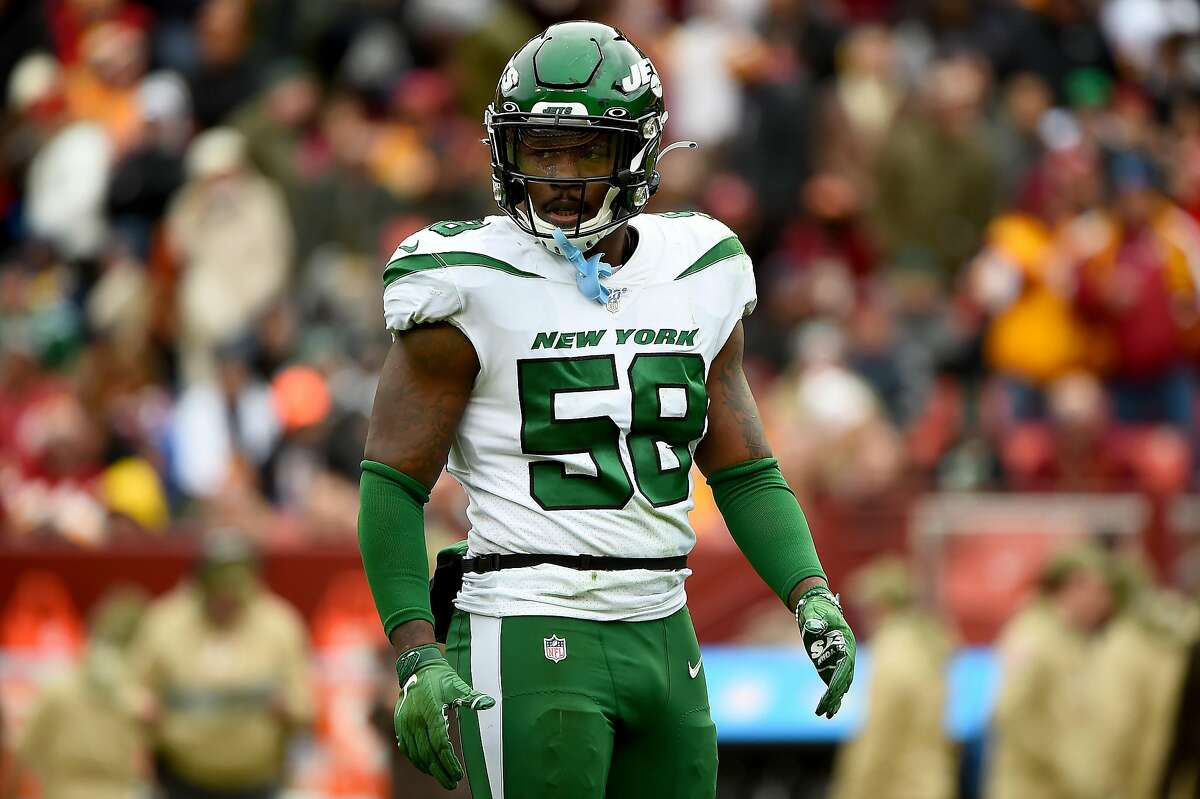 LANDOVER, MD - NOVEMBER 17: James Burgess #58 of the New York Jets looks on during the first half against the Washington Redskins at FedExField on November 17, 2019 in Landover, Maryland. (Photo by Will Newton/Getty Images)