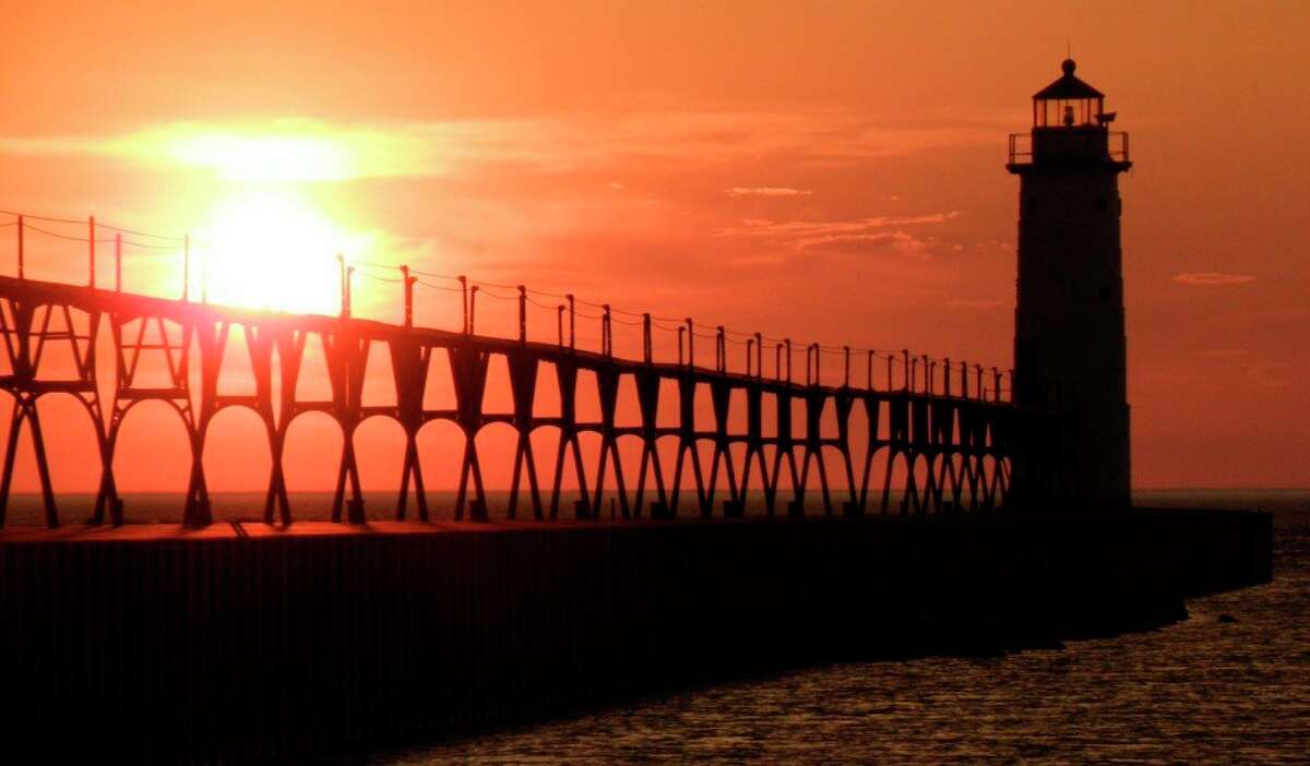 Fifth Avenue Beach is a fantastic place to watch the setting sun, whether from the sand or on the pier. (File photo)