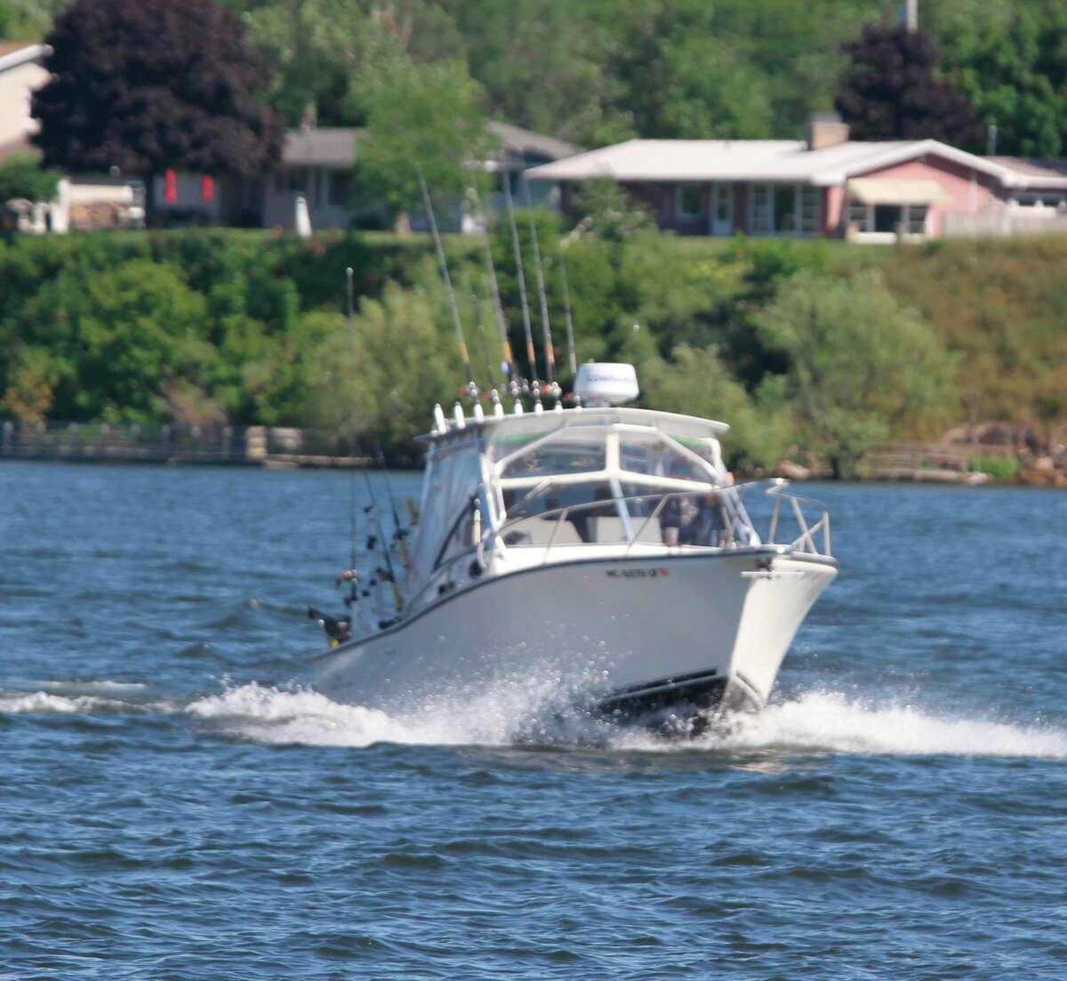 A fishing boat makes its way through the Manistee River channel toward Lake Michigan. (File photo)