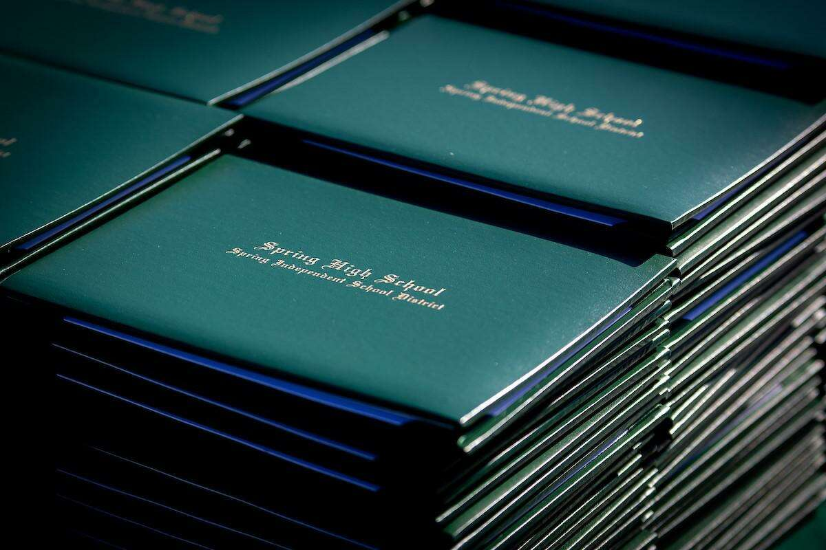 A stack of diplomas sit ready to distribute to graduates during the Spring High School Class of 2020 graduation ceremony last year at Planet Ford Stadium