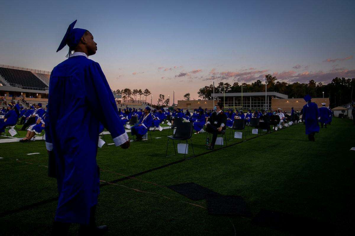 Dekaney High School Class of 2020 students attend their graduation ceremony last year at Planet Ford Stadium.
