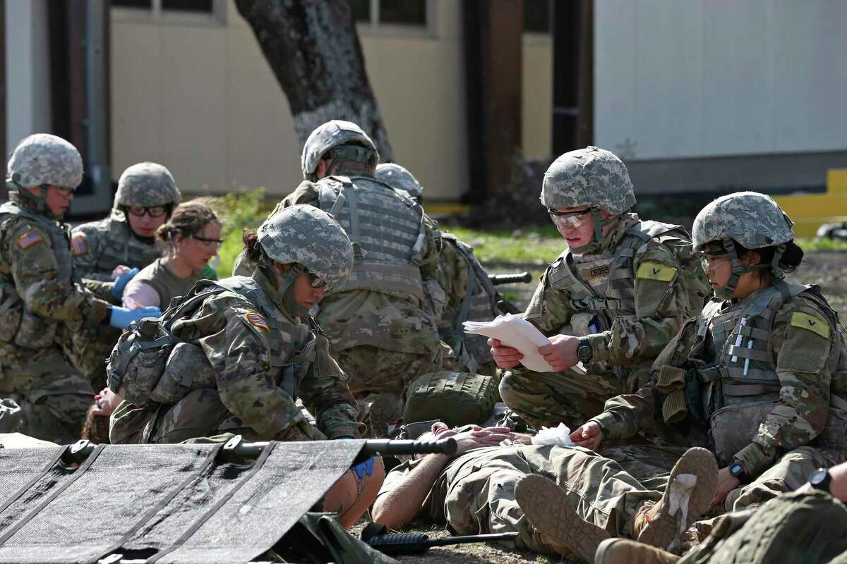 U.S. Army medics in training in 2017 at Fort Sam Houston include (center left to right) Pvt. Margie Jiminez, 18, of Houston, Pfc. Ronald Cross, 19, of Washington, D.C. and Pfc. Irene Cheng, 19, of Seattle. With the pandemic easing, trainees will be allowed off the post this weekend to visit San Antonio for the first time in 14 months.