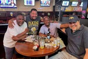From left, James Walker, Antonio, state Rep. Travis Simms and attorney Steve Kobak at The Blue Rhino in Norwalk.