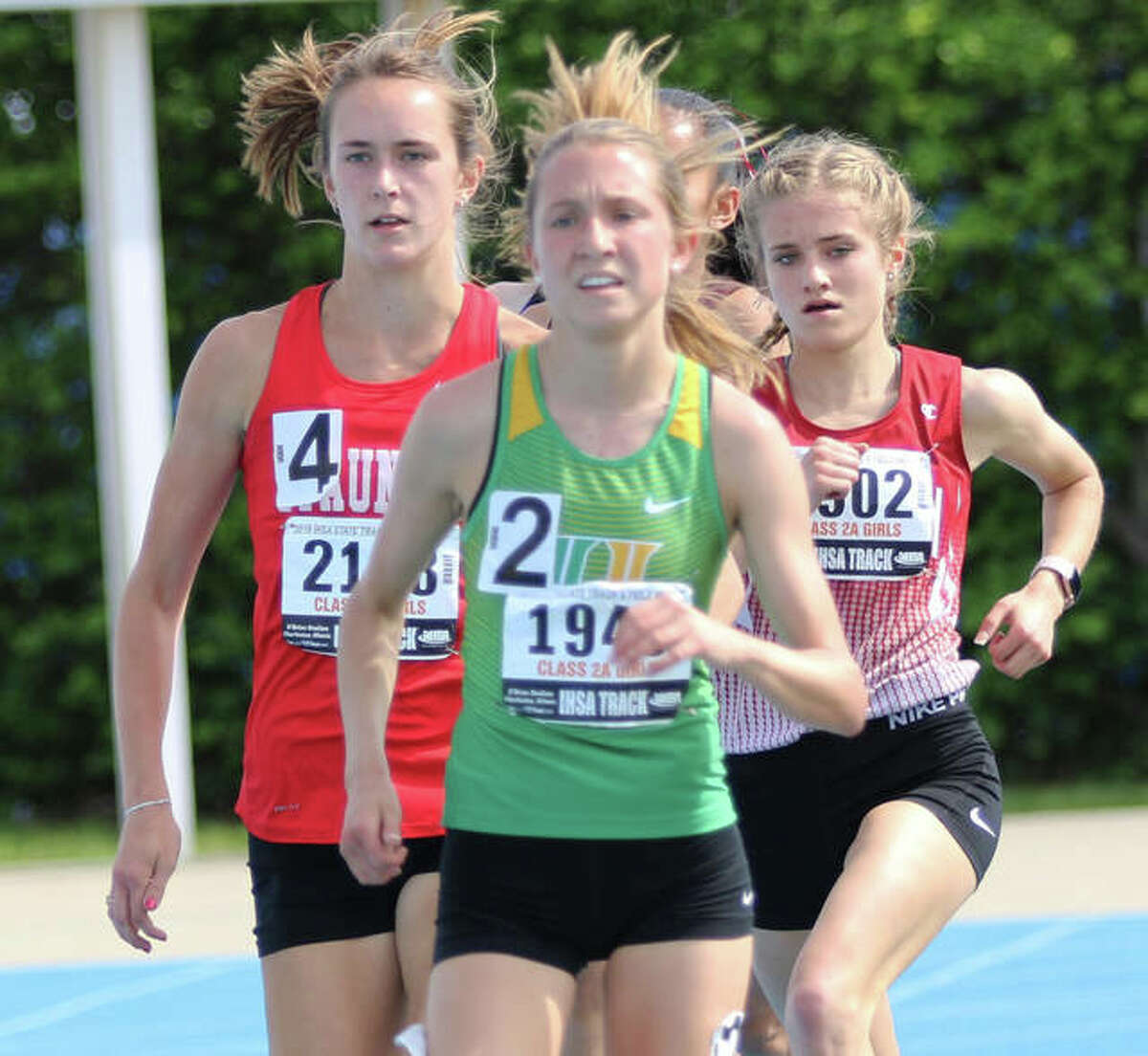 Staunton's Lydia Roller (left) runs in second place during the 1,600 meters at the Class 2A state meet in Charleston as a sophomore in 2019. Roller, recovering from a stress fracture this spring, has made an unexpected return in May and won the 3,200 meters Thursday at the SCC Meet in Pana.