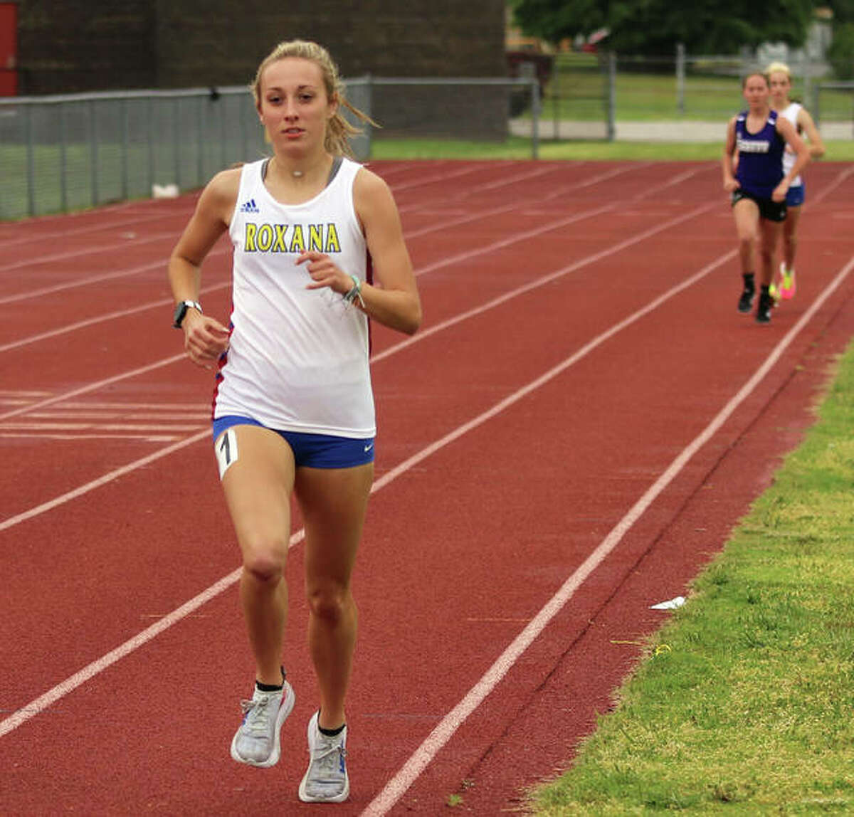 Roxana's Janelynn Wirth (left), shown winning the 1,600 meters at the Madison County Meet on May 17 in Wood River, won the 1,600 and was second in the 3,200 on Thursday at the SCC Meet in Pana.