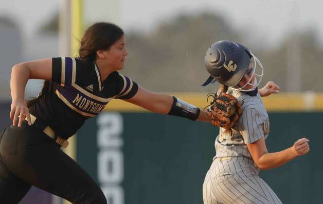 Shelby Winn #8 of Lake Creek is tagged out in a rundown by Montgomery third baseman Montgomery third baseman Taylenn Allen (10) during the second inning of a high school softball game at Lake Creek High School, Tuesday, March 16, 2021, in Montgomery. Photo: Jason Fochtman/Staff Photographer