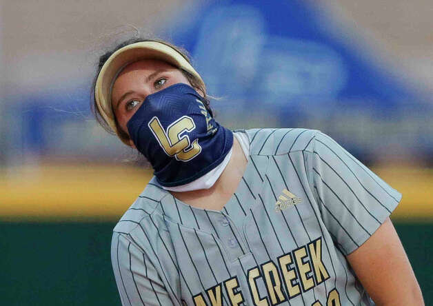 Lake Creek second baseman Ava Brown (22) wears a face mask as she talks with starting pitcher Emiley Kennedy during the first inning of a high school softball game at Lake Creek High School, Tuesday, March 16, 2021, in Montgomery. Photo: Jason Fochtman/Staff Photographer