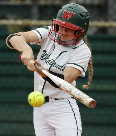 Kaelyn Zusi #29 of The Woodlands hits a single during the third inning of a high school softball game at The Woodlands High School, Saturday, Feb. 27, 2021, in The Woodlands. Photo: Jason Fochtman/Staff Photographer / 2021 ? Houston Chronicle