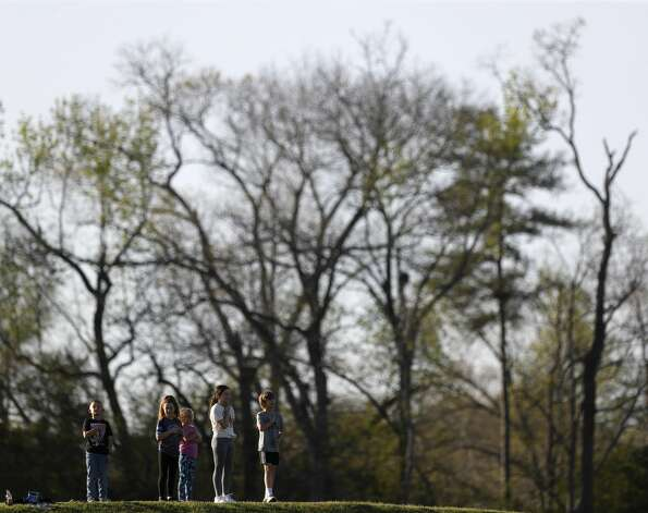 Fans stand for the national anthem before a District 13-6A high school softball game at Willis High School, Tuesday, March 23, 2021, in Willis Photo: Jason Fochtman/Staff Photographer / 2021 © Houston Chronicle