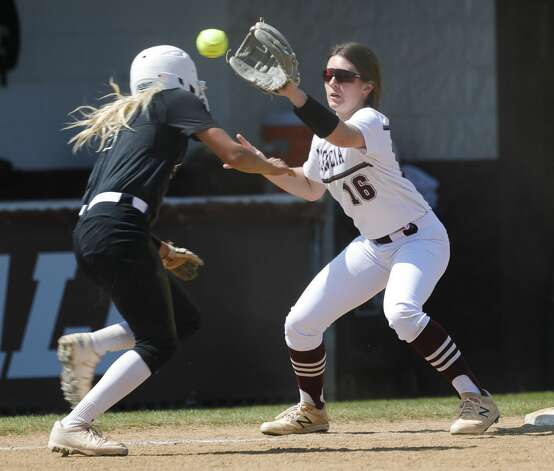 Magnolia shortstop Jade Bubke (16) catches a throw to third base to get out Bella Gonzales #11 of Katy Paetow in the fourth inning of a District 19-5A high school softball game at Magnolia High School, Saturday, March 20, 2021, in Magnolia. Photo: Jason Fochtman/Staff Photographer / 2021 © Houston Chronicle