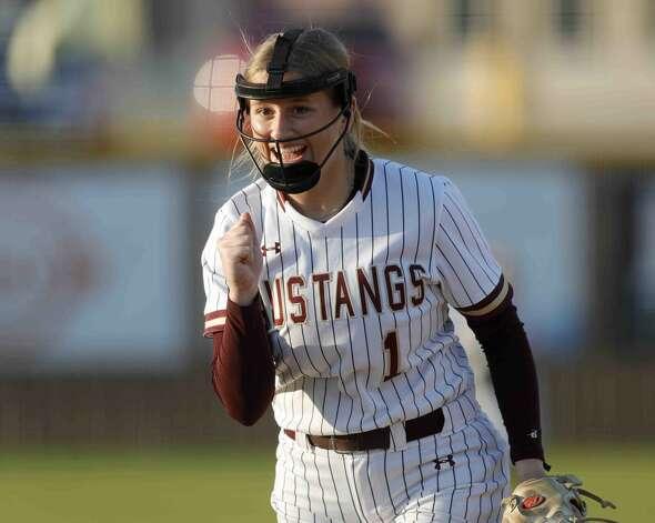 Magnolia West starting pitcher Toni Tamborello (1) gives a fist-pump after striking out Jenna Hardy #4 of Brenham to end the top of the first inning of a high school softball game at Magnolia West High School, Thursday, April 1, 2021, in Magnolia. Photo: Jason Fochtman/Staff Photographer / 2021 © Houston Chronicle