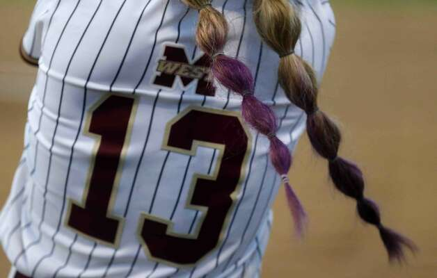 The dyed braids of Alivia Kiser #13 of Magnolia West are seen during the third inning of a high school softball game at Magnolia West High School, Thursday, April 1, 2021, in Magnolia. Photo: Jason Fochtman/Staff Photographer / 2021 © Houston Chronicle