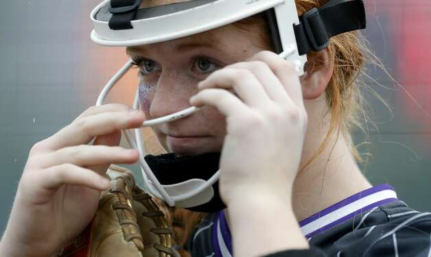 Willis starting pitcher Kynlei Chapman (11) adjusts her face masks during the third inning of a District 13-6A high school softball game at Willis High School, Friday, April 16, 2021, in Willis. Photo: Jason Fochtman/Staff Photographer / 2021 © Houston Chronicle