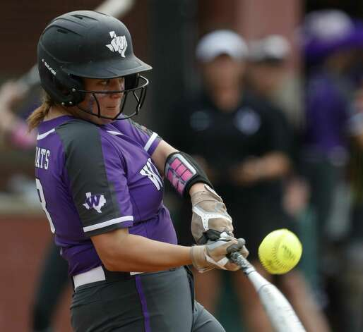 Willis designated hitter Kyndal Murphy (13) connects for a 2-RBI single during the second inning of a Region II-6A bi-district high school softball playoff game at Willis High School, Thursday, April 29, 2021, in Willis. Photo: Jason Fochtman/Staff Photographer / 2021 © Houston Chronicle