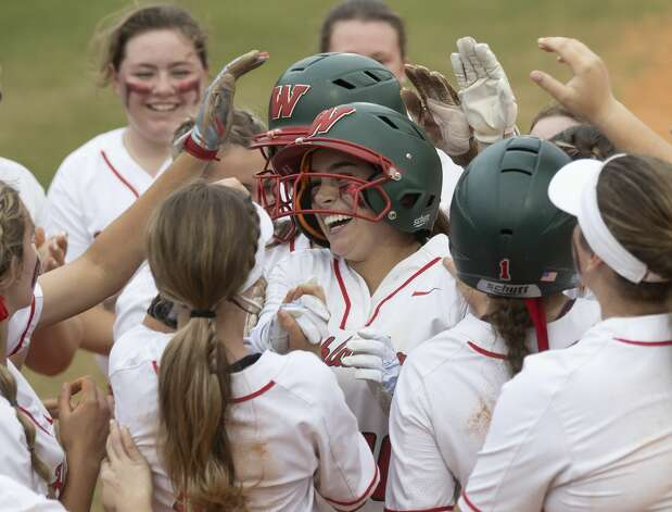 Gabby Leach #10 of The Woodlands reacts as she's embraced by her teammates after hitting a homerun during the second inning of a Region II-6A bi-district playoff game at The Woodlands High School, Thursday, April 29, 2021, in The Woodlands. Photo: Gustavo Huerta/Staff Photographer / Houston Chronicle © 2021