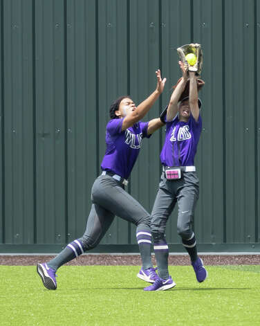 Willis center fielder Kaleyanna Bankheard (1) and right fielder Jolie Boyd (15) collide into one another as they attempt to catch a flyball during the first inning in Game 2 of a Region II-6A area playoff series against Cypress Woods at Cypress Woods High School, Saturday, May 8, 2021, in Cypress. Photo: Gustavo Huerta/Staff Photographer / Houston Chronicle © 2021