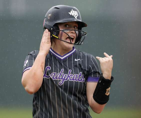 Lainey Niederhofer #5 of Willis jokes with players on her bench that she can't hear them after reaching third on Marissa Fletcher's RBI double during the fourth inning of a District 13-6A high school softball game at Willis High School, Friday, April 16, 2021, in Willis. Photo: Jason Fochtman/Staff Photographer / 2021 © Houston Chronicle