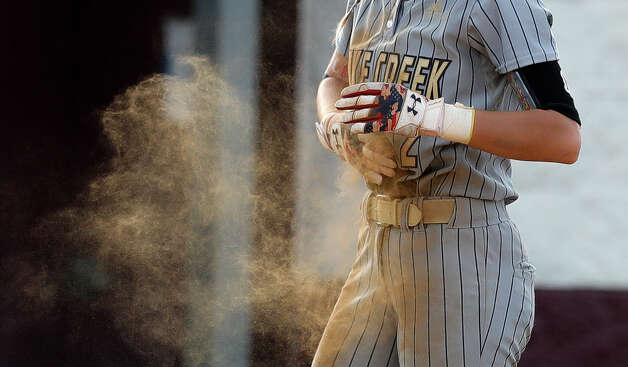 Maddie Mckee #2 of Lake Creek dusts off her jersey after hitting an RBI triple during a one-game Region III-5A quarterfinal game at Magnolia High School, Friday, May 14, 2021, in Magnolia. Photo: Jason Fochtman/Staff Photographer / 2021 © Houston Chronicle