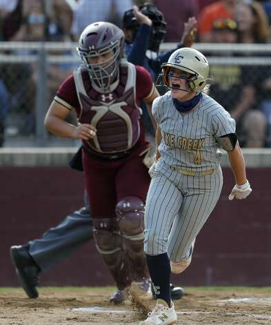 Caelee Clark #4 of Lake Creek reacts after getting hit by a pitch from Magnolia West starting pitcher Toni Tamborello during a one-game Region III-5A quarterfinal game at Magnolia High School, Friday, May 14, 2021, in Magnolia. Photo: Jason Fochtman/Staff Photographer / 2021 © Houston Chronicle