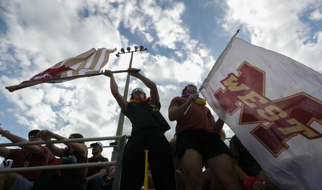 Magnolia West fans Gage Luckman, left, and Cole Savoy cheer during a one-game Region III-5A quarterfinal game at Magnolia High School, Friday, May 14, 2021, in Magnolia. Photo: Jason Fochtman/Staff Photographer / 2021 © Houston Chronicle