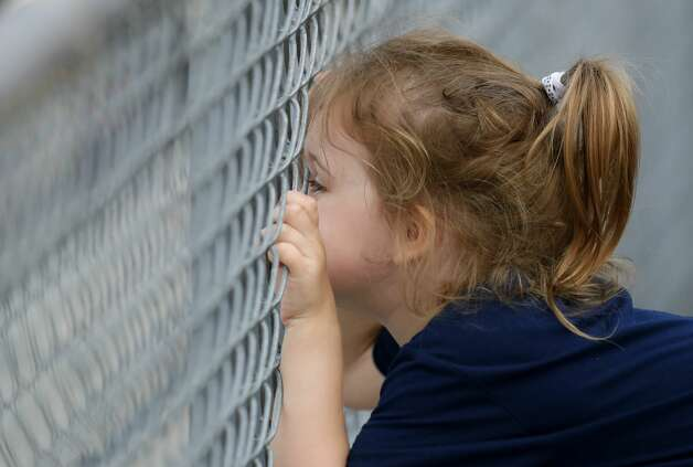 Lakelyn Loftin watches play in the first inning of a one-game Region III-5A semifinal at Grand Oak High School, Thursday, May 20, 2021, in Spring. Photo: Jason Fochtman/Staff Photographer / 2021 © Houston Chronicle