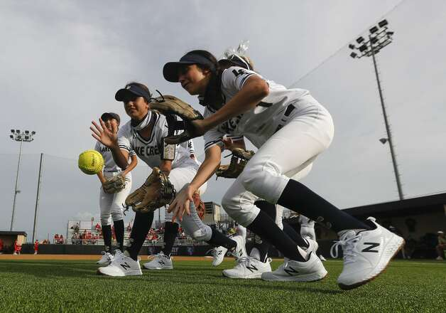 Lake Creek players play a game before a one-game Region III-5A semifinal at Grand Oak High School, Thursday, May 20, 2021, in Spring. Photo: Jason Fochtman/Staff Photographer / 2021 © Houston Chronicle