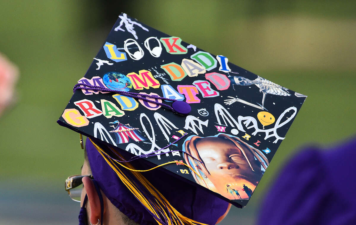 Lyndon B. Johnson High School graduates don their decorated graduation caps at the Bill Johnson Student Activity Complex, Thursday, May 27, 2021, during the school's graduation ceremony.