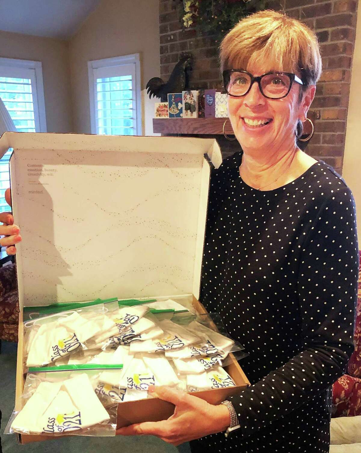 With her alma mater in mind, Middletown Mercy High School alumna LuAnn Hardacker created a Mercy blue and gold mask.