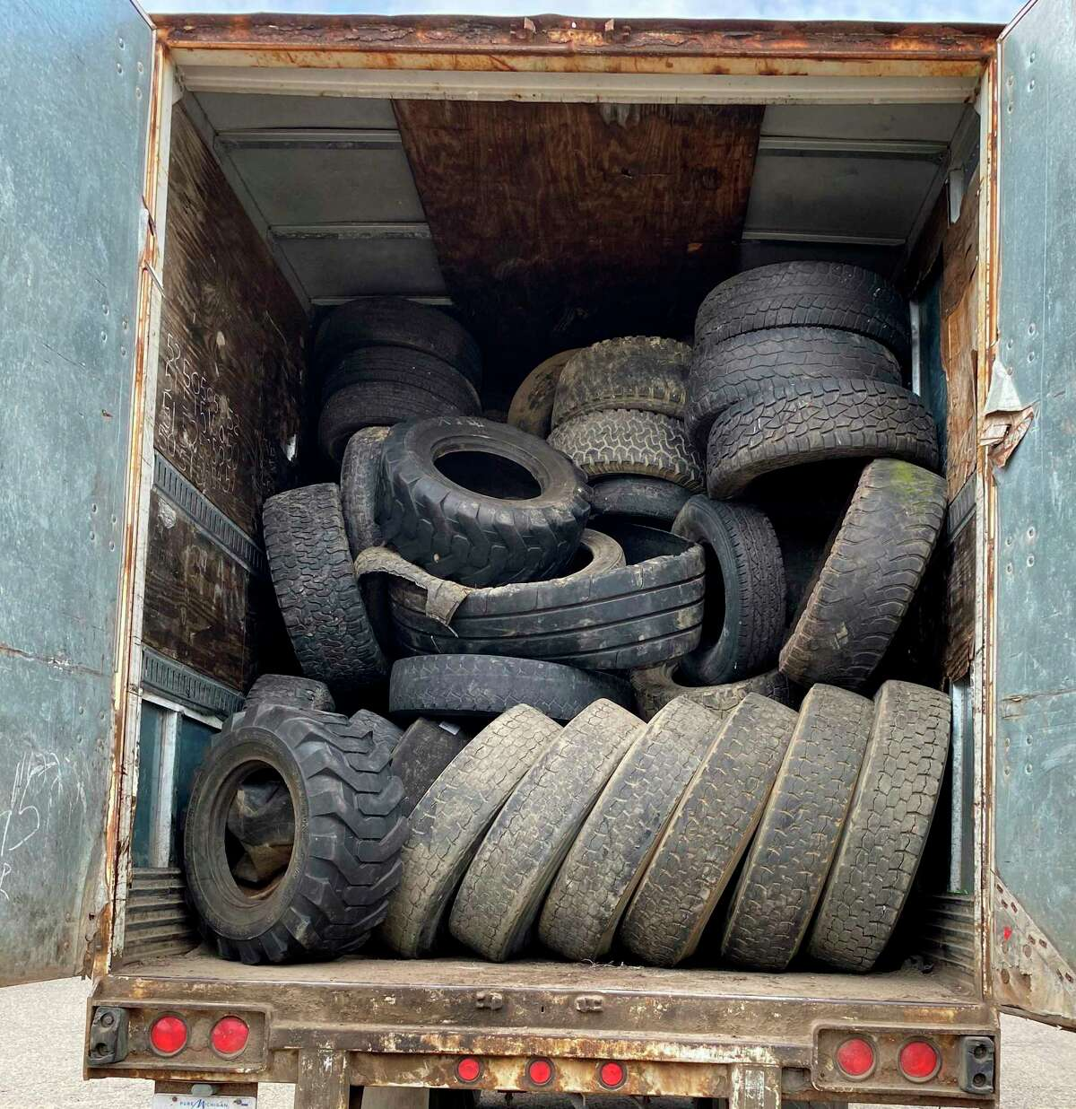 A semi trailer is full of scrap tires collected during the Huron Conservation District's scrap tire drive. (Courtesy Photo)