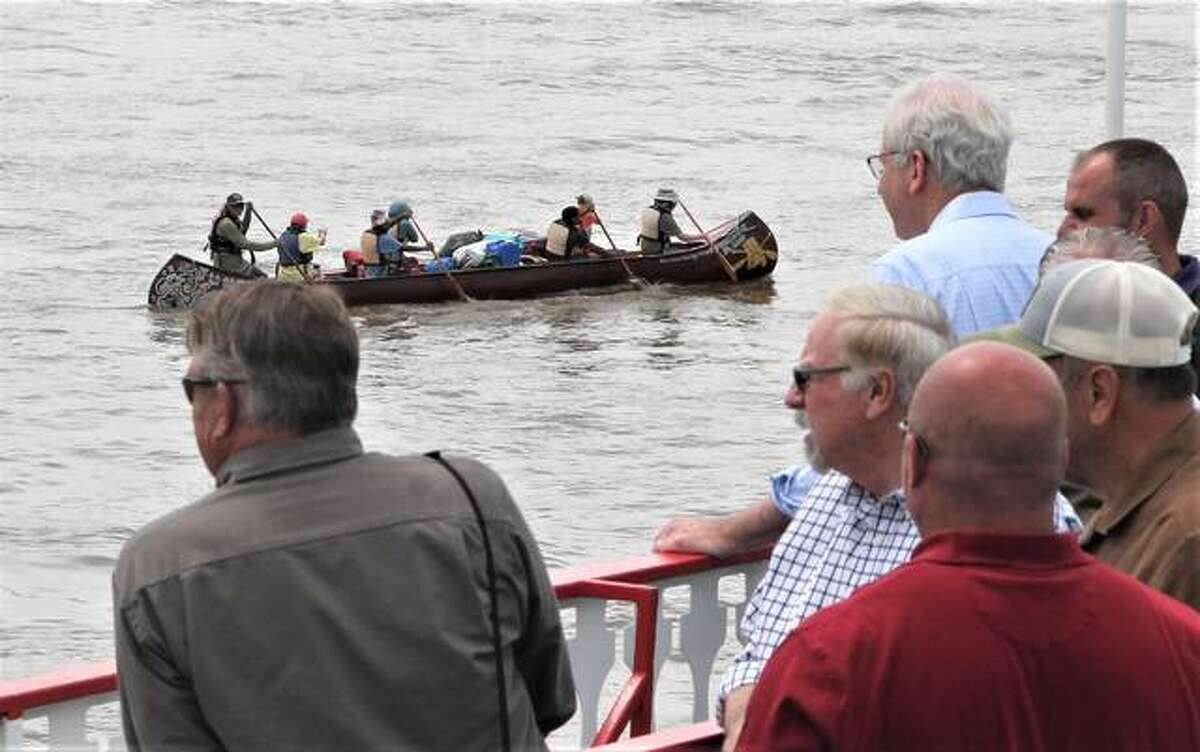 Participants of a riverboat cruise on the Tom Sawyer watch as several canoes go by. The tour was one of the few live events of FreightWeekSTL2021, an annual industry conference sponsored in part by St. Louis Regional Freightway, an arm of Bi-State Development. The tour gave people a chance to see the industrial operations on the river, as well as infrastructure improvement.