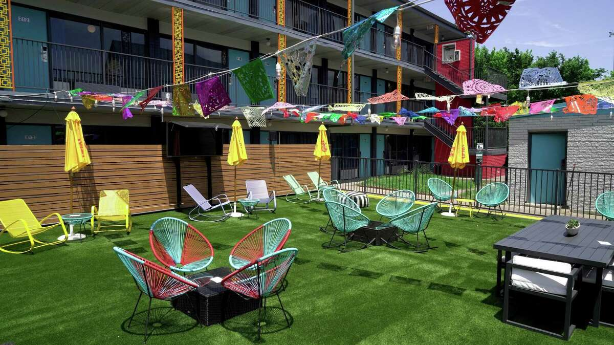 What was once part of the parking lot has been transformed into an artificial turf lawn near a pavilion and pool at the new Heights House Hotel.